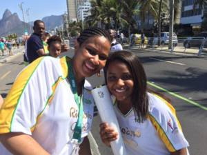 Phumzile Mlambo-Ngcuka and Thaiza Vitória carrying the Olympic Torch